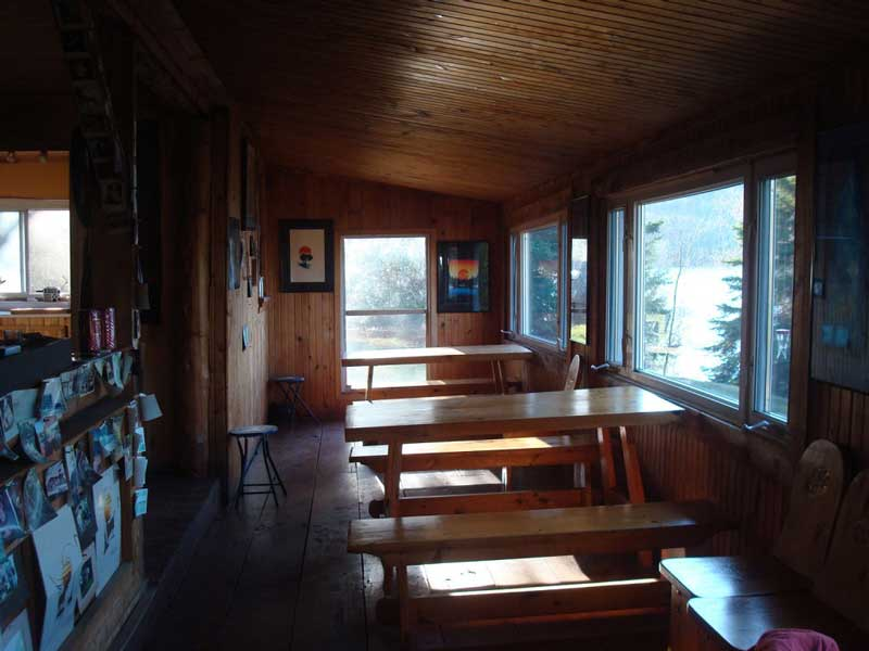 Blue Lake Camp - trout fishing lodge on Kirkpatrick Lake indoor cabin view tables for a fish fry