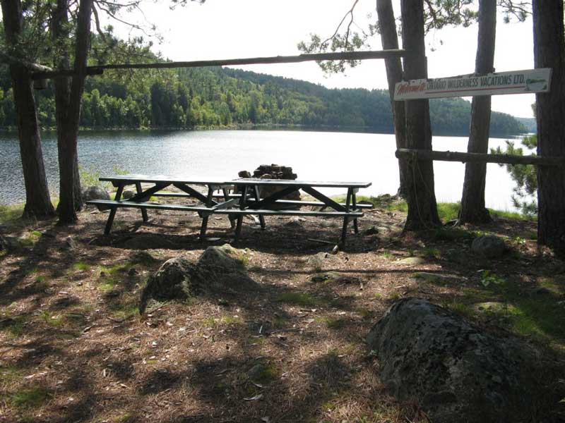 picnic benches for a trout fish fry after a day of excellent fishing Blue Lake Camp - fishing lodge on Kirkpatrick Lake