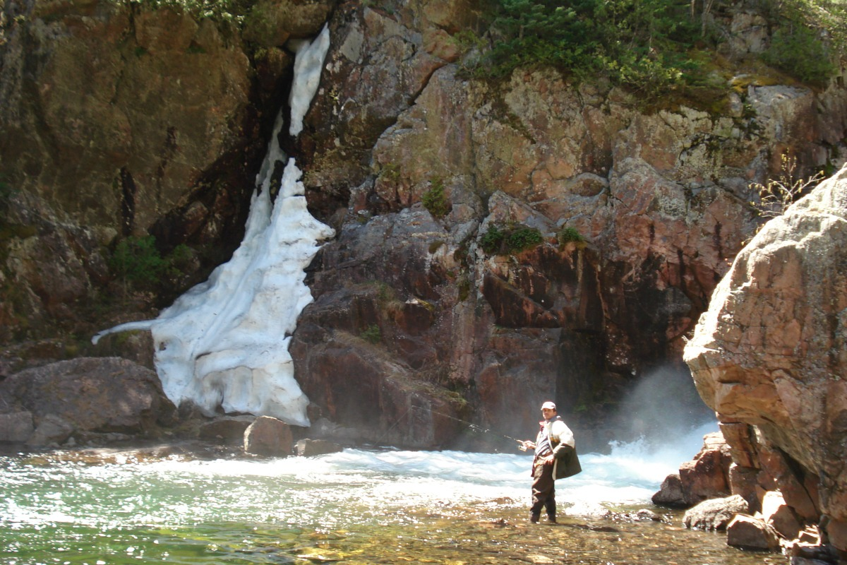 Fishing at the waterfall, Blue Fox Camp